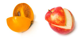 Persimmon and apple Royalty Free Stock Photos