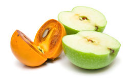 Persimmon and apple Royalty Free Stock Photo