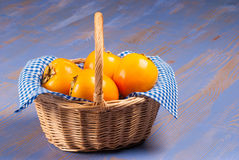 Persimmon basket Stock Photo