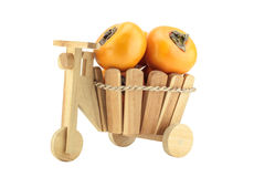 Persimmon in a basket Royalty Free Stock Image