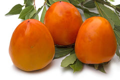 Persimmon and bay leaves Royalty Free Stock Photography