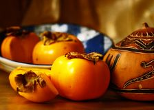 Persimmon in Blue Bowl Royalty Free Stock Photography