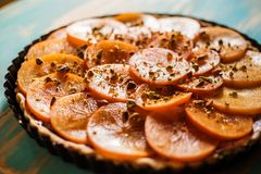 Persimmon and blueberries cream tart Royalty Free Stock Photography