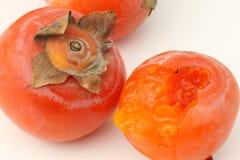 Persimmon close-up, peeled persimmon Stock Photos