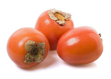 Persimmon in closeup. Persimmon mellow in closeup white background stock images