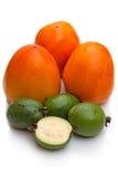 Persimmon and feijoa on white Stock Photo