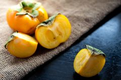 Persimmon fresh close up on background Stock Photos