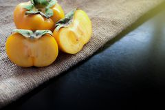 Persimmon fresh close up on background Royalty Free Stock Photography
