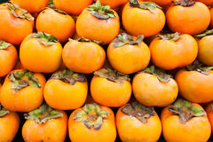 Persimmon fruit background Stock Photos