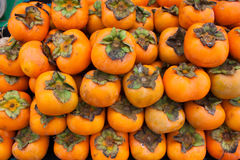 Persimmon fruit background Royalty Free Stock Images