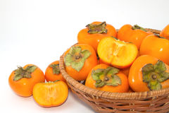 Persimmon fruit in the basket Stock Photos