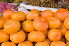 Persimmon fruit in a Cambodian Market Stock Image