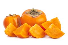 Persimmon fruit closeup on white royalty free stock photos