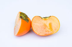 Persimmon fruit cut one side front Stock Photo