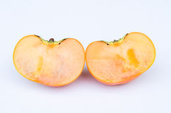 Persimmon fruit cut two side Royalty Free Stock Photo