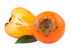 Persimmon Fruit and half of fruit Royalty Free Stock Image