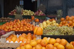 For persimmons there was no place. Persimmon is a fruit that I buy very little. It`s expensive, you can buy it tart. Sellers knowing this for beauty expose it to Stock Image