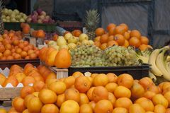 For persimmons there was no place. Persimmon is a fruit that I buy very little. It`s expensive, you can buy it tart. Sellers knowing this for beauty expose it to Stock Photography