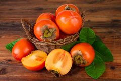 Persimmon fruits in a basket Stock Images