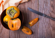 Persimmon fruits in a bowl Royalty Free Stock Images