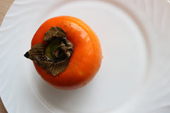 Persimmon. Happy all for its unusually delicate and sweet taste Stock Images