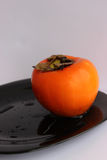 Persimmon. Happy all for its unusually delicate and sweet taste Stock Image