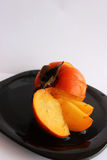 Persimmon. Happy all for its unusually delicate and sweet taste royalty free stock image