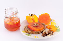Persimmon. Jam her bread and walnuts on white background royalty free stock photography