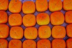 Persimmon kaki fruits at rural market. In Hakodate, Japan Stock Photo