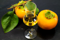 Persimmon liqueur Royalty Free Stock Photography