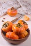 Persimmon na stole Zdjęcie Royalty Free