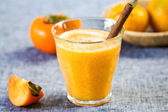 Persimmon with orange smoothie Royalty Free Stock Images
