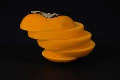 Persimmon owoc z plasterkami Zdjęcie Stock