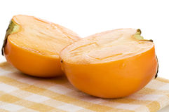 Persimmon on placemat isolated Royalty Free Stock Image