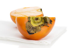 Persimmon on placemat isolated Stock Photos