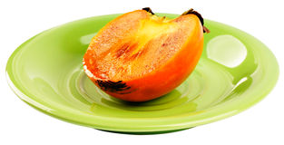 Persimmon on plate Stock Photos