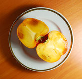 Persimmon in plate Royalty Free Stock Images