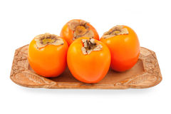 Persimmon on a plate Stock Photo