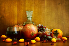 Persimmon, pomegranate and citrus fruits. Persimmon, pomegranate and citrus on textural background Stock Photo