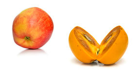 Persimmon and red apple Stock Photo