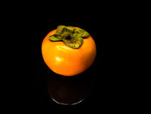 Persimmon on Reflect Royalty Free Stock Photos