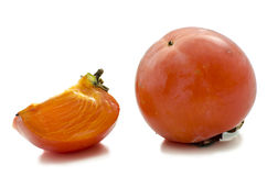 Persimmon and a slice Stock Images