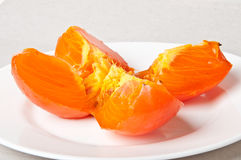 Persimmon slices Stock Image