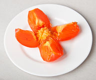 Persimmon slices Stock Photography
