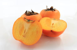The persimmon. Three balls resting on a white background Royalty Free Stock Photography