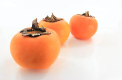 The persimmon. Three balls resting on a white background Royalty Free Stock Photo