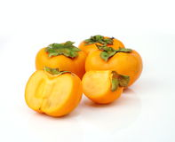 Persimmon tropical fruit slice on half Royalty Free Stock Photos
