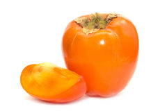 Persimmon whole and slice. On white background Stock Photo