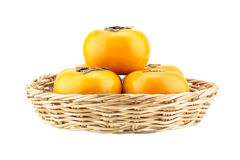 Persimmon in wicker basket Royalty Free Stock Image