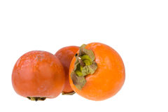 Persimmons. Isolated on the whte background Stock Photo